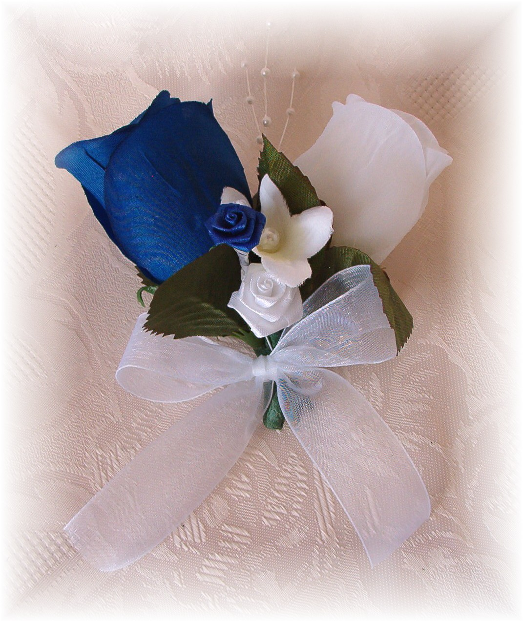 Ivory Roses Bouquet With Royal Blue And Silver Accents The Bridal Flower